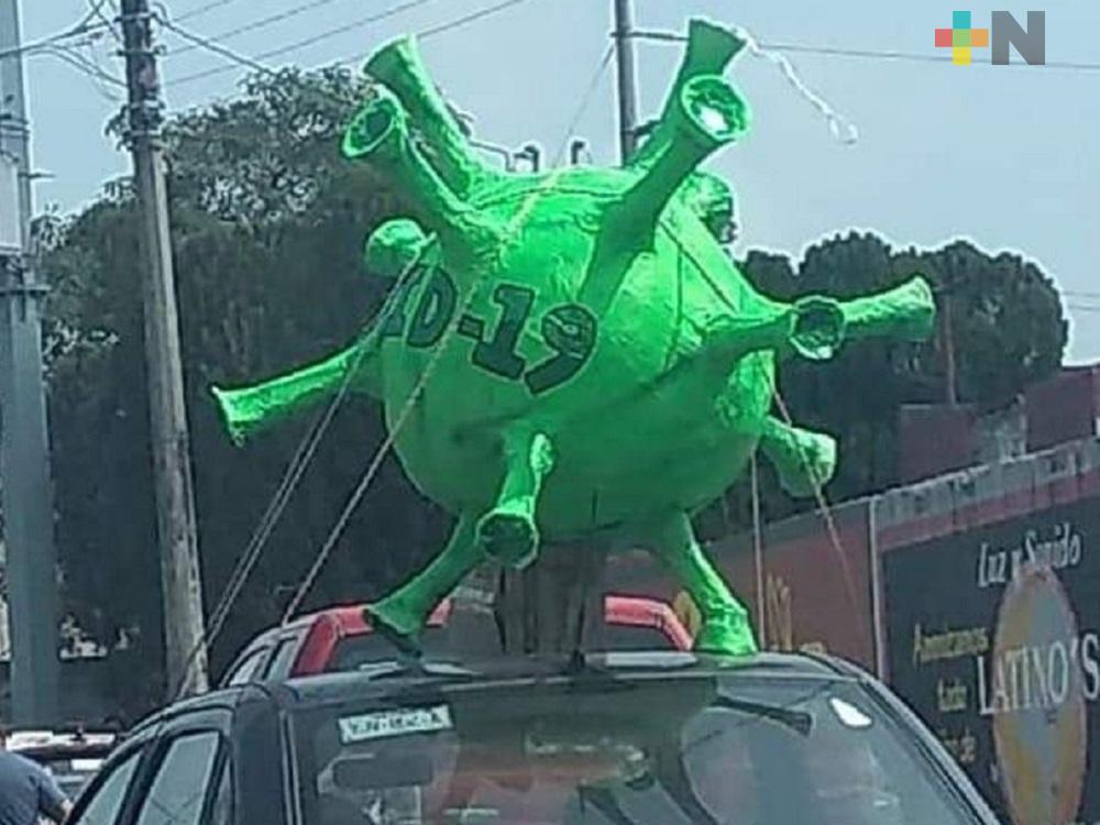 Piñata de Covid-19, transita por calles de Las Choapas