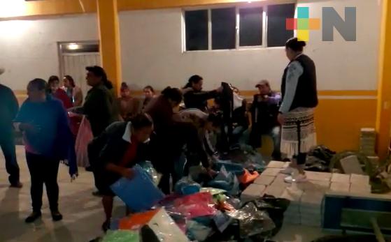 Comunidades de Zacualpan reciben ropa nueva, donada por la FGR delegación Xalapa